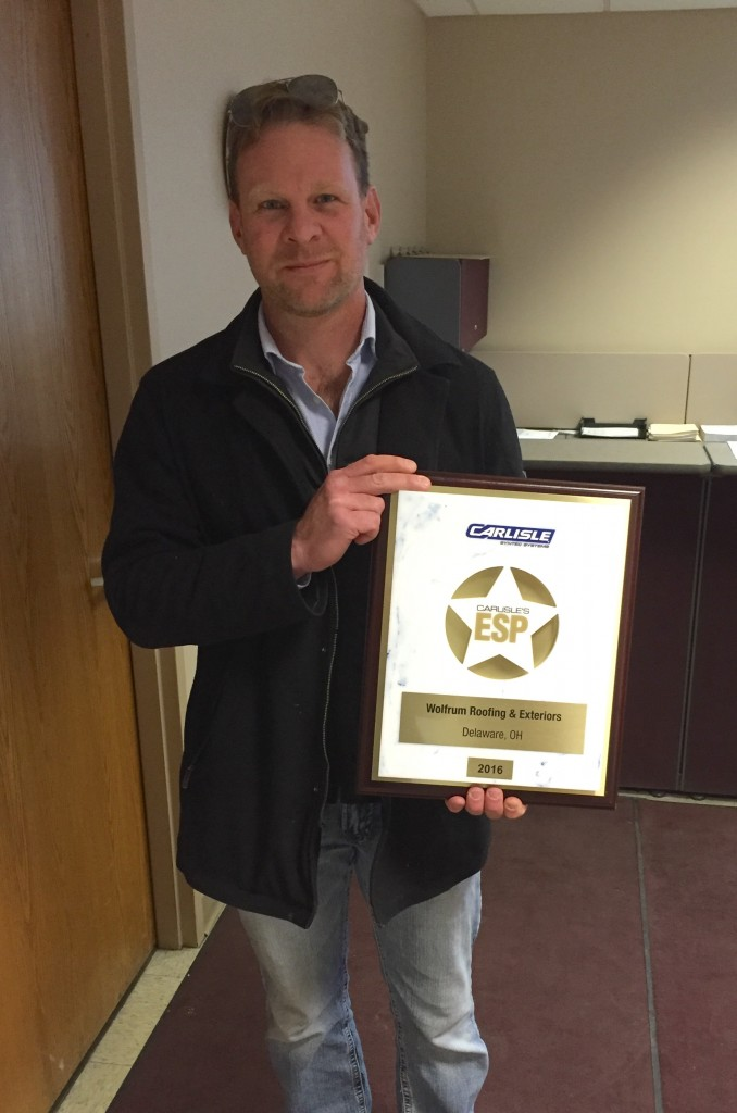 Joe Wolfrum shows off WRE's newest recognition.
